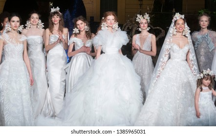 BARCELONA / SPAIN - APRIL 24: models posing at the end of the Marchesa catwalk during the Barcelona Bridal Fashion Week runway collection 2020 on April 24, 2019 in Barcelona, Spain.