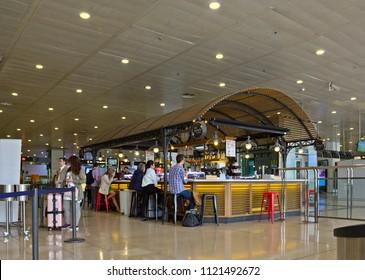 BARCELONA, SPAIN - APRIL 25, 2018: Interior of Railway station Barcelona Sants  with cafe