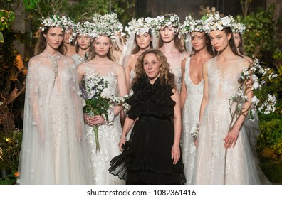 BARCELONA / SPAIN - APRIL 25: models posing with designer Reem Acra at the end of the Reem Acra catwalk during the Barcelona Bridal Fashion Week runway collection 2019 on April 25, 2018 in Barcelona,