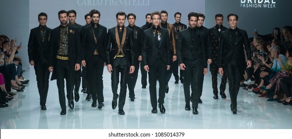 BARCELONA / SPAIN - APRIL 25: models walking on the Carlo Pignatelli catwalk during the Barcelona Bridal Fashion Week runway collection 2019 on April 25, 2018 in Barcelona, Spain.