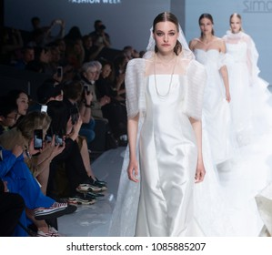 BARCELONA / SPAIN - APRIL 25: models walking on the Simone Marulli catwalk during the Barcelona Bridal Fashion Week runway collection 2019 on April 25, 2018 in Barcelona, Spain.