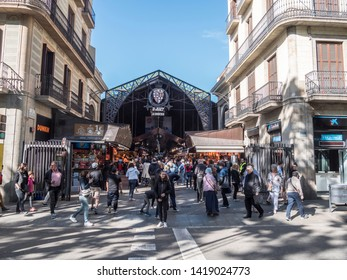 Barcelona, Spain - April 26, 2019: La Boqueria is a historic food market situated at the famous Ramblas at Barcelona, Spain.
