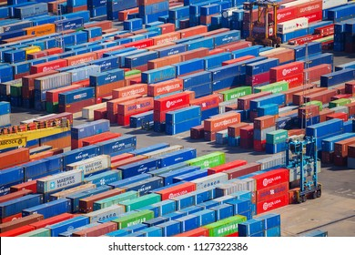 BARCELONA, SPAIN - APRIL 27, 2018: Unloading of cargo containers in the port of Barcelona in Spain