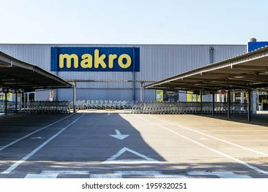 Barcelona, Spain - April 5, 2021. Logo and facade of Makro, a chain of self-service wholesales stores