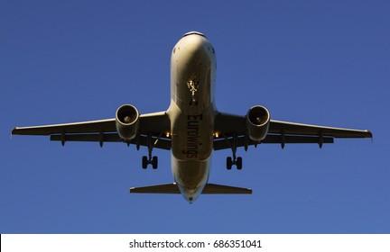 Barcelona / Spain - April.8.2017 - A Eurowings Airbus A320-214 landing at El Prat Airport
