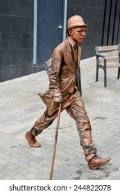 Barcelona, Spain - Aug 20, 2014: Street performer in Barcelona, acting like a bronze statue
