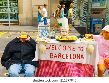 BARCELONA, SPAIN -AUG 25, 2009: Performer give show at the famous Ramblas street in Barcelona, Spain on Aug 25, 2009.