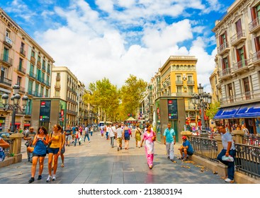 BARCELONA, SPAIN -AUG 25, 2009: The famous Ramblas street with unidentified walking tourists in Barcelona, Spain on Aug 25, 2009.