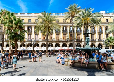 BARCELONA, SPAIN - AUGUST 05, 2016: People Gathering In Royal Square (Placa Reial or Plaza Real) a Well-Known Tourist Attraction Of Barcelona