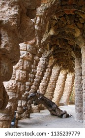 BARCELONA, SPAIN - AUGUST 11, 2007: Park Guell in Barcelona unhewn stone buttresses of the Portico of the washerwoman Parc Guell designed by Antoni Gaudi, Barcelona - Spain