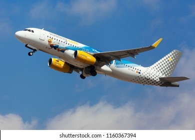 Barcelona, Spain - August 15, 2018: Vueling Airbus A320 with 25 Years Disneyland special livery taking off from El Prat Airport in Barcelona, Spain.