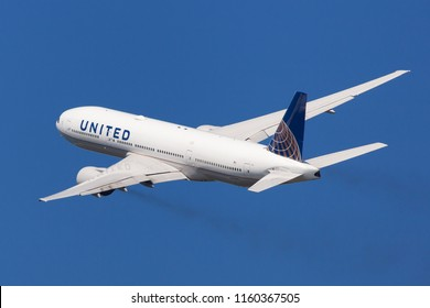 Barcelona, Spain - August 15, 2018: United Airlines Boeing 777-200 banking left after taking off from El Prat Airport in Barcelona, Spain.