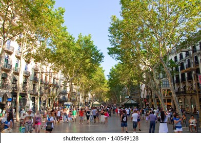 BARCELONA, SPAIN - AUGUST 16: La Rambla on August 16, 2012 in Barcelona, Spain. Thousands of people walk daily by this popular pedestrian area 1.2 kilometer-long.