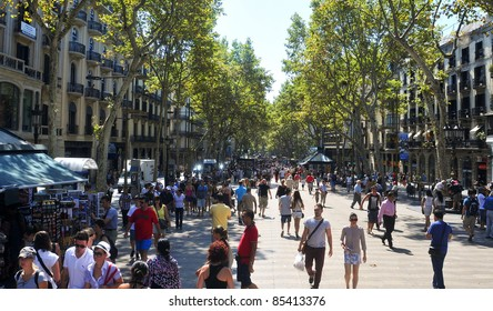 BARCELONA, SPAIN - AUGUST 16: La Rambla on August 16, 2011 in Barcelona, Spain. Thousands of people walk daily by this popular pedestrian area 1.2 kilometer-long