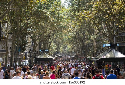 BARCELONA, SPAIN - AUGUST 19, 2013: The busy high street of La Rambla in Barcelona during the day on August 19 2013