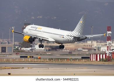 Barcelona, Spain - August 19, 2016: Vueling Airbus A320 landing at El Prat Airport in Barcelona, Spain.
