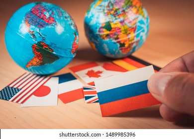 BArcelona, Spain. August 19:Earth globe toy balls with Flags of the Great 7 or Big seven countries and Russia. Suitable for readmission or rejection of Russia from the G8, economic political concept
