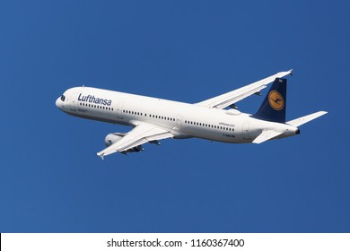 Barcelona, Spain - August 20, 2018: Lufthansa Airbus A321-100 banking left after taking off from El Prat Airport in Barcelona, Spain.