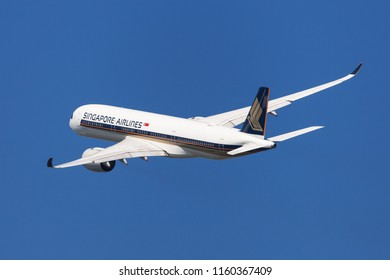 Barcelona, Spain - August 20, 2018: Singapore Airlines Airbus A350-900 banking left after taking off from El Prat Airport in Barcelona, Spain.