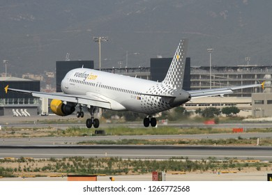 BARCELONA, SPAIN - AUGUST 21, 2012: Vueling Airlines Airbus 320 lands to the El Prat International Airport