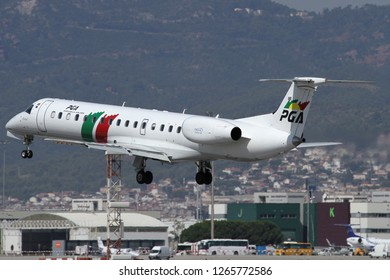 BARCELONA, SPAIN - AUGUST 21, 2012: PGA Portugália Airlines EMBRAER E145 lands to the El Prat International Airport
