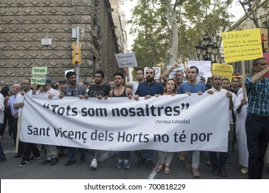 BARCELONA, SPAIN - AUGUST 21, 2017: Muslim protesters march on Las Ramblas Streets in memory of 13 individuals who died during a terrorist attack in the city of Barcelona.