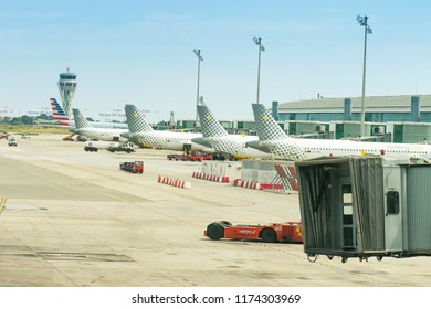 Barcelona, Spain - august 21, 2018: Aircraft Vueling in El Prat airport in Barcelona stand in a row in departure gateways