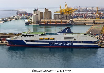 BARCELONA, SPAIN - August 27, 2012: Aerial top down harbor and trucks embarking the Grimaldi Lines Ferry in the port ship in import export and business logistic of Barcelona, Catalunya, Spain, Europe