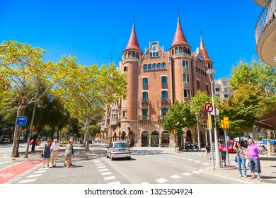 Barcelona, Spain - August 27, 2014: People walk near Casa de les Punxes or Casa Terradas is a building designed by the modernist architect Josep Puig i Cadafalch, it was build in 1905