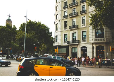 Barcelona, Spain -  August 28, 2013; View on building with Levi's store in the downtown near La Rambla and taxi on the front.