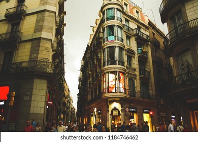 Barcelona, Spain -  August 28, 2013; View on building with shop windows in the downtown near La Rambla.