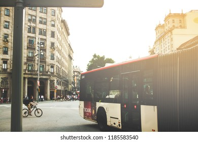 Barcelona, Spain -  August 28, 2013; View on buildings with bus and cyclist in the downtown near La Rambla.
