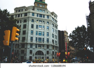 Barcelona, Spain -  August 28, 2013; View on building  in the downtown near La Rambla and cars on the front.