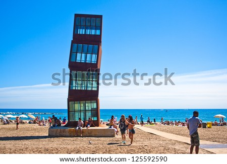 BARCELONA, SPAIN - AUGUST 31: Barceloneta Beach on August 31, 2012 in Barcelona, Spain. The sculpture designed by installation artist Rebecca Horn in COR-TEN steel presides over this urban beach.