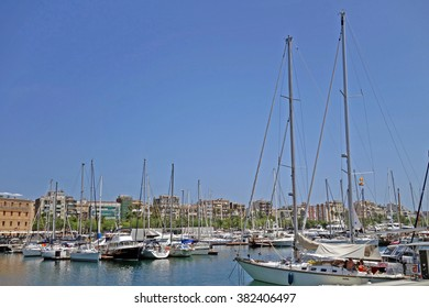 BARCELONA, SPAIN - AUGUST 6, 2015: Boats and yachts parked during a hot summer noon at port of Barcelona, Spain