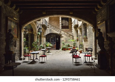 Barcelona, Spain - August 9, 2015: Palau Dalmases Espai Barroc - historic palace restaurant archway entrance, located in El Born district of Barcelona Spain Europe.