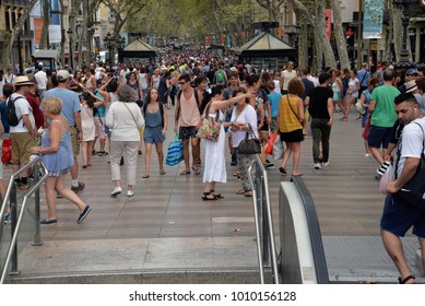 BARCELONA, SPAIN -  August 9, 2016:  people walk daily by street in downtown of Barcelona on August 9, 2016