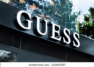 BARCELONA, SPAIN - AUGUST 9, 2018: Closeup of the signboard of the Guess store in the famous Passeig de Gracia avenue in Barcelona, Spain, one of the most important streets in the city