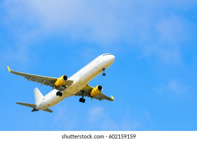 BARCELONA, SPAIN - August/20/2016: Airplane Vueling is flying over Barcelona.