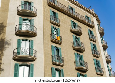 Barcelona, Spain Catalan flag on a building balcony. The starred flag La Senyera Estelada hanging outside a house in the streets of the Catalan capital.