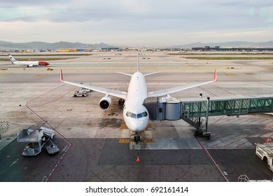 BARCELONA, SPAIN - CIRCA NOVEMBER, 2015: passenger jet airplane docked at Barcelona Airport. Barcelona-El Prat Airport is an international airport. It is the main airport of Catalonia, Spain.
