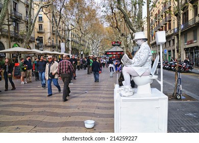 BARCELONA, SPAIN - DEC 20: A street artist performs at Les Rambles street on December 20, 2009 in Barcelona, Spain.