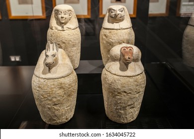 Barcelona, Spain - Dec 27th, 2019: Set of canopic jars of limestone. 26th Dynasty. Museum of Ancient Egypt Culture of Barcelona, Spain