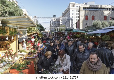 BARCELONA, SPAIN - DECEMBER 08: Unidentified people visits the famous Santa Llucia Festival to buy Christmas decoration, as pines trees and crib figures, on December 08, 2012, in Barcelona, Spain.