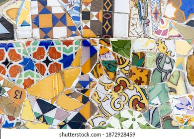 Barcelona, Spain  - December 12, 2020: Gaudí's colorful and emblematic mosaic work on the main terrace of the Park Güell in Barcelona