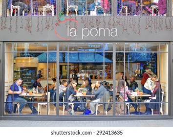 BARCELONA, SPAIN - DECEMBER 14: People having lunch in street cafe in Barcelona city centre on December 14, 2014. Barcelona is the capital of Catalonia and second largest city of Spain.