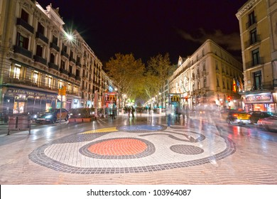 BARCELONA, SPAIN - DECEMBER 15: Joan Miro's Pla de l'Os mosaic in La Rambla on December 15, 2011 in Barcelona, Spain. Thousands of people walk daily on the mosaic, designed by famous artist Joan Miro
