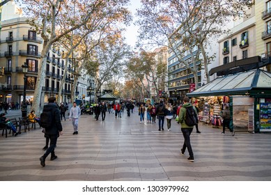 BARCELONA, SPAIN - DECEMBER 19, 2018: La Rambla in Barcelona, Spain. La Rambla is a street in central Barcelona, between El Raval and Barri Gotic district