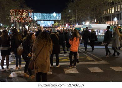 Barcelona, Spain - December 1st, 2016: View of a street food in the city center on Passeig De Gracia street.