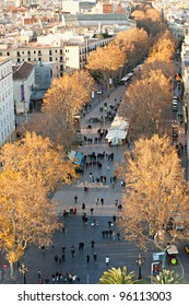 BARCELONA, SPAIN - DECEMBER 20: Aerial view of  La Rambla on December 20, 2011 in Barcelona, Spain. Thousands of people walk daily by this popular pedestrian area 1.2 kilometer-long